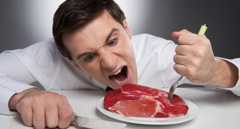 22549941 - hungry man can not wait till meat is cooked